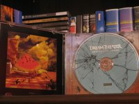Opened Case with booklet on the left and CD on right
